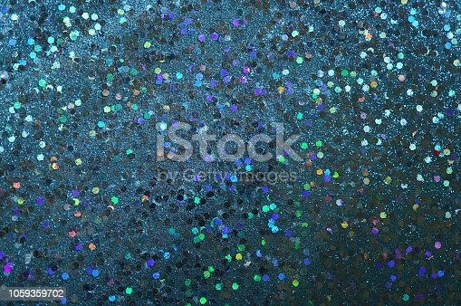 872229066 istock photo Blue glitter background 1059359702