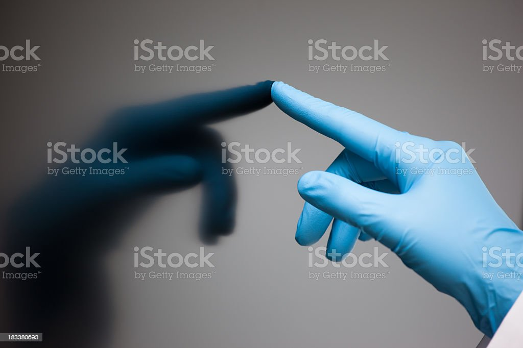 Blue gloved hand touching reflection royalty-free stock photo