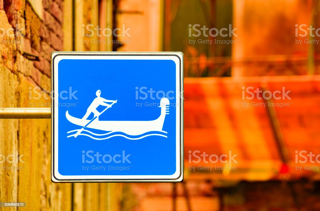 Blue Gondola cannel sign in Venice, Italy stock photo