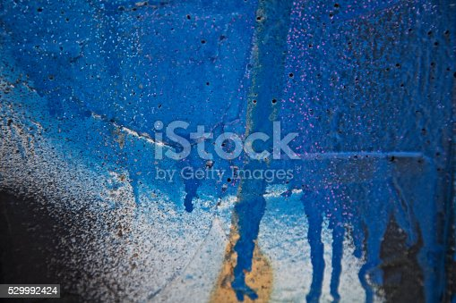1084390994istockphoto blue graffiti abstract background patterns urban city concrete wall 529992424