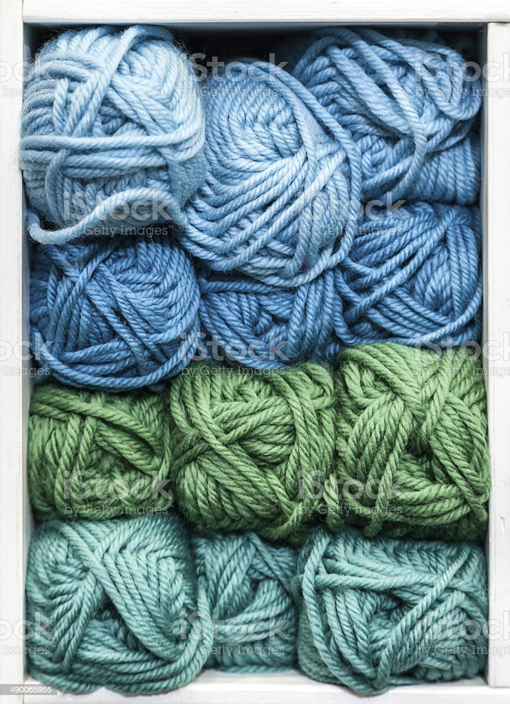 Blue, Green and Teal Balls of Wool for Knitting stock photo