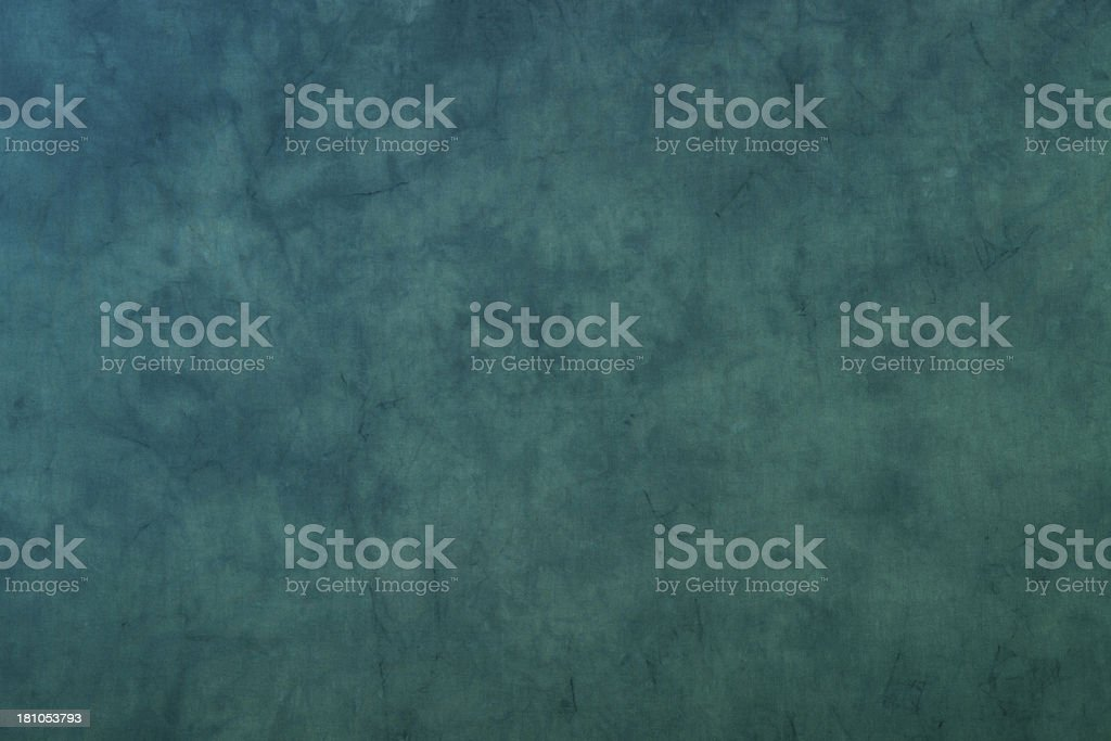 Blue green dyed muslin background. stock photo