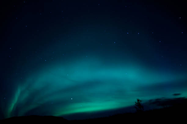Blue green northern lights  under the big dipper over Iceland The aurora borealis radiates bright blues and greens in Iceland. The big dipper constellation can be seen in the sky big dipper constellation stock pictures, royalty-free photos & images