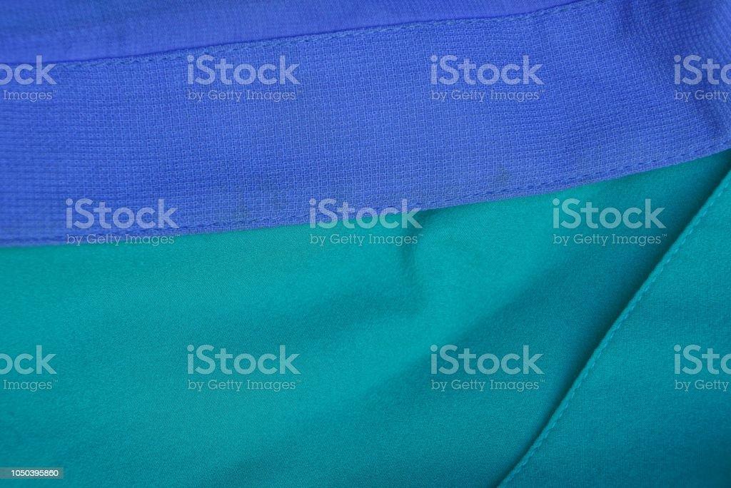青い緑テクスチャ生地のしわの問題点の ストックフォト