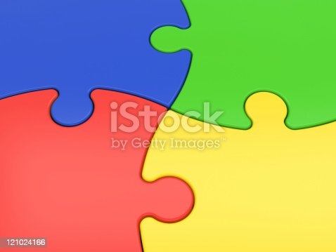 istock Blue, green, yellow and red interconnected puzzle pieces 121024166