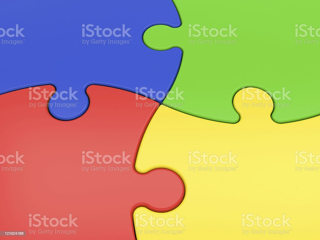 Blue, green, yellow and red interconnected puzzle pieces stock photo