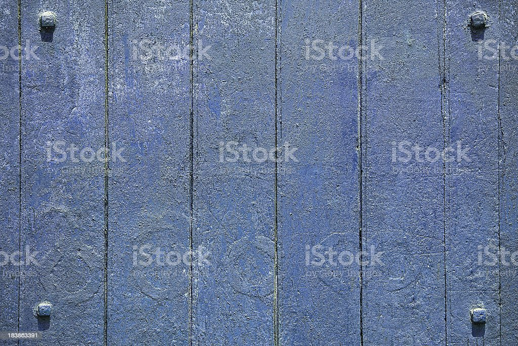 Blue grunge wood background with four framing studs. royalty-free stock photo
