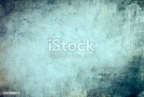 istock blue grungy canvas background or texture 1042998012