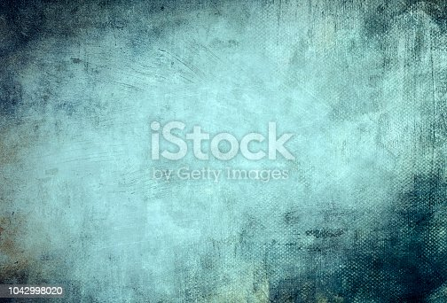 istock blue grungy canvas background or texture 1042998020