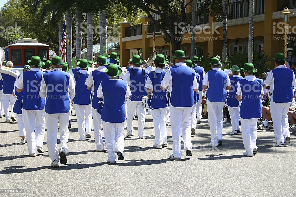 Blue Guys With Green Hats stock photo
