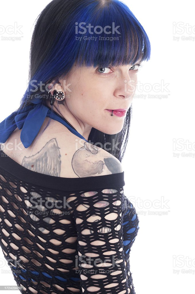 Blue haired young woman smiling back over shoulder. royalty-free stock photo
