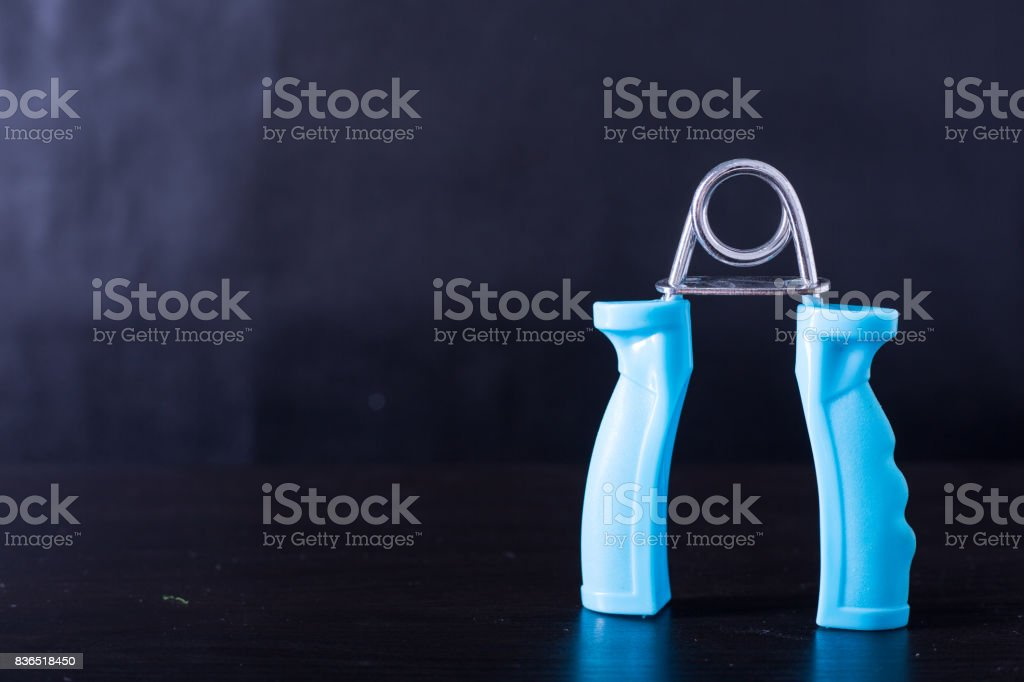 Blue Hand Gripper stock photo
