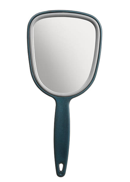 a blue hand held mirror on a white background - handspiegel stockfoto's en -beelden