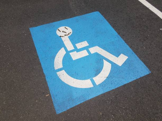 blue handicapped symbol with flowers making a face stock photo