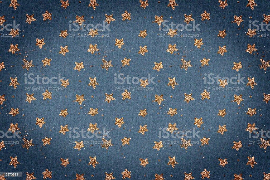 Blue handmade paper with golden stars stock photo