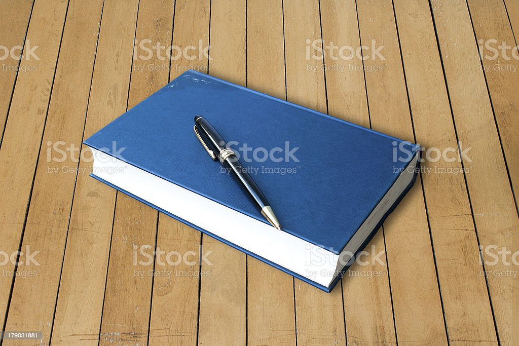 blue hardcover with pen book royalty-free stock photo