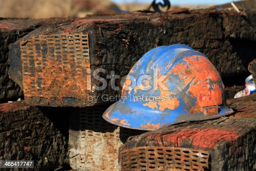 A well worned hardhat used by a railroad worker.