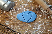 Blue Heart shape cut out on rolled icing sugar. Taken in May UK.