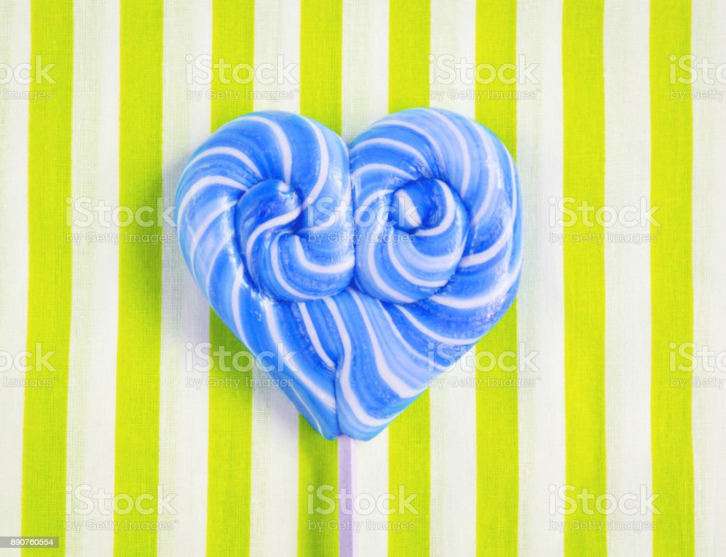 Blue heart shaped lollipop for St Valentines stock photo