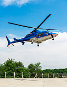 Blue Helicopter landing on the ground in Istanbul, Turkey.