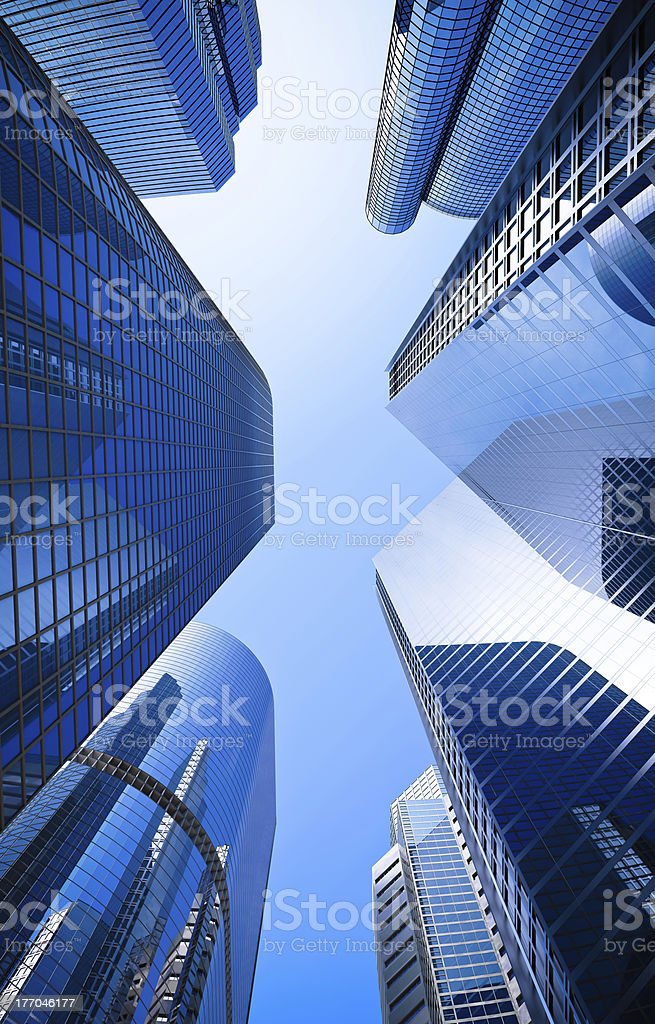 blue highrise glass skyscraper street low angle shot stock photo