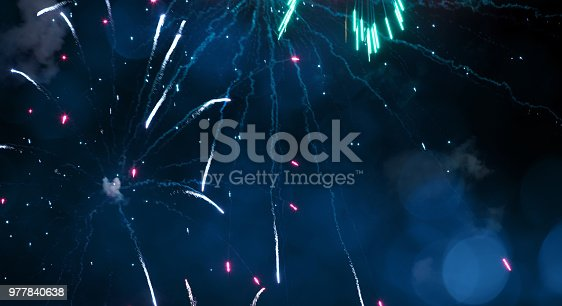 977840698 istock photo Blue Holiday background with fireworks 977840638