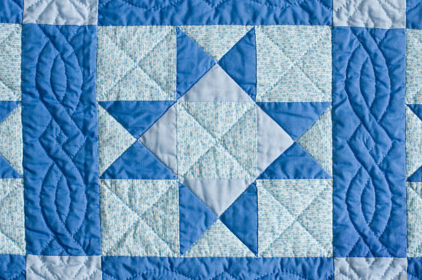blue home made quilt star pattern - quilt stock photos and pictures