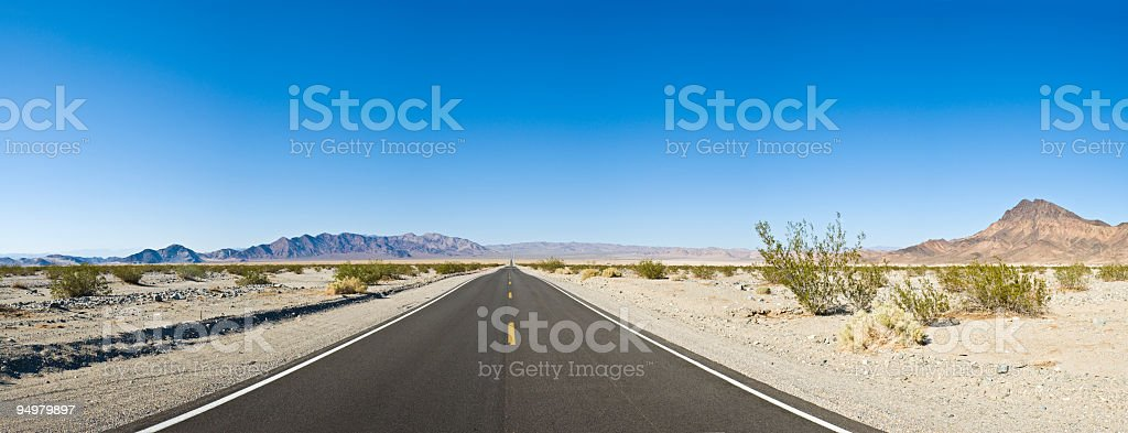 Blue horizon, black highway stock photo
