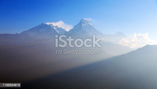 Blue horizon of Annapurna 1 I and Annapurna south, round Annapurna circuit trekking trail, Nepal Himalayas mountains