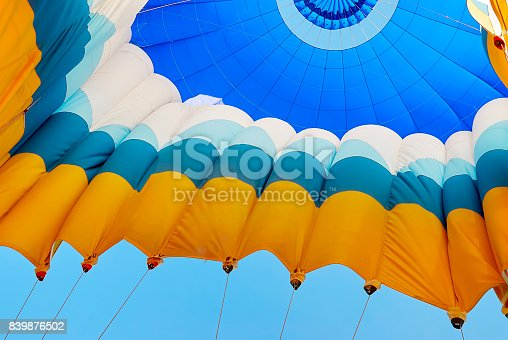 istock Blue hot air balloon inflating - view inside, Turkey 839876502
