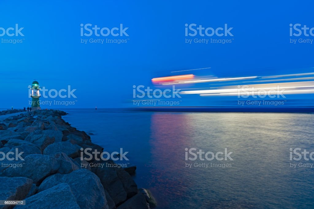 Blue hour at the  lighthouse of Rostock-Warnemunde stock photo