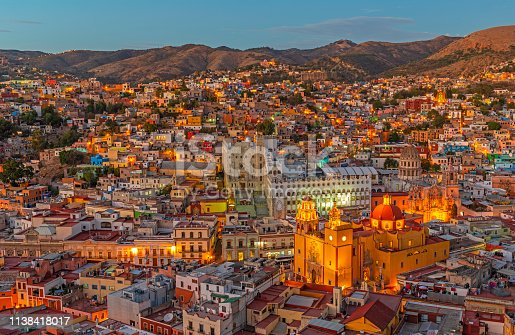 Cityscape of Guanajuato city during the blue hour with the famous orange Basilica of Our Lady of Guanajuato, Mexico.