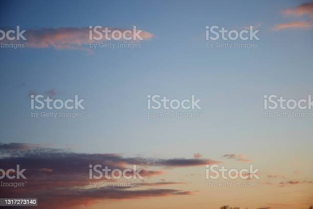 Photo of Blue hour - gorgeous sunset sky with pink twinkle clouds. Natural background