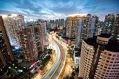 illuminated shanghai skyline at sunset hour