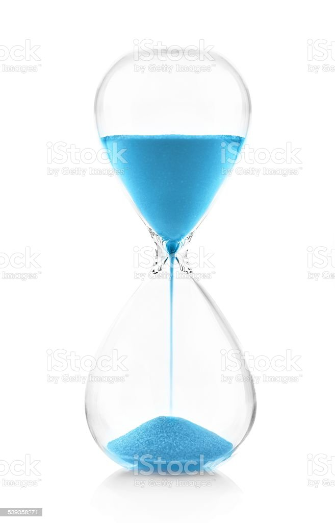 Blue hourglass on white close up stock photo