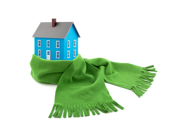 Blue house wrapped in a scarf isolated on white stock photo