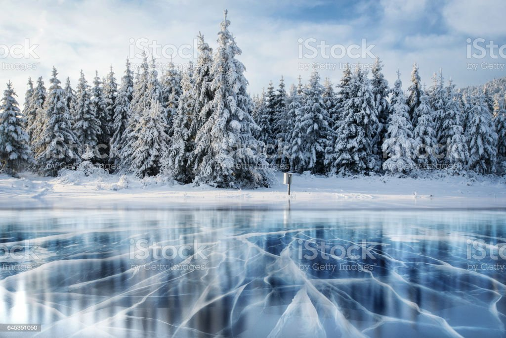 Blue ice and cracks on the surface of the . stock photo