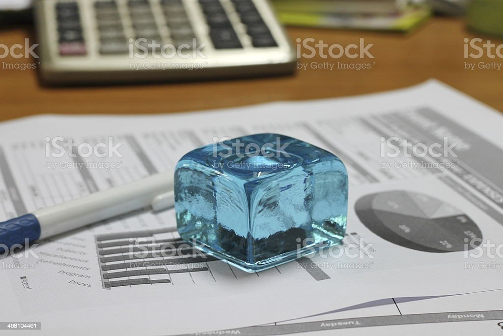 Blue ice cube paperweight stock photo