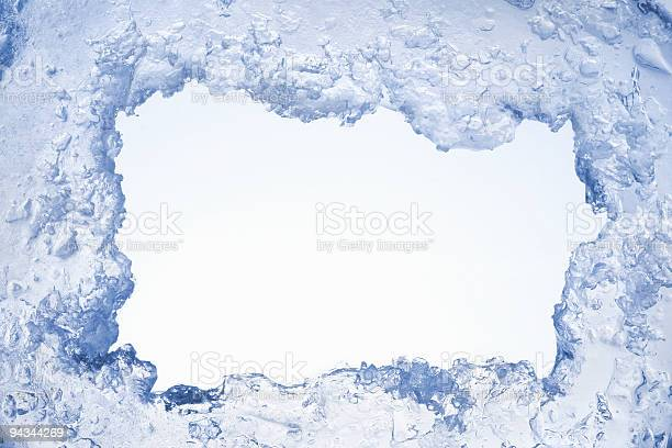 Photo of Blue ice framing blank pale blue background