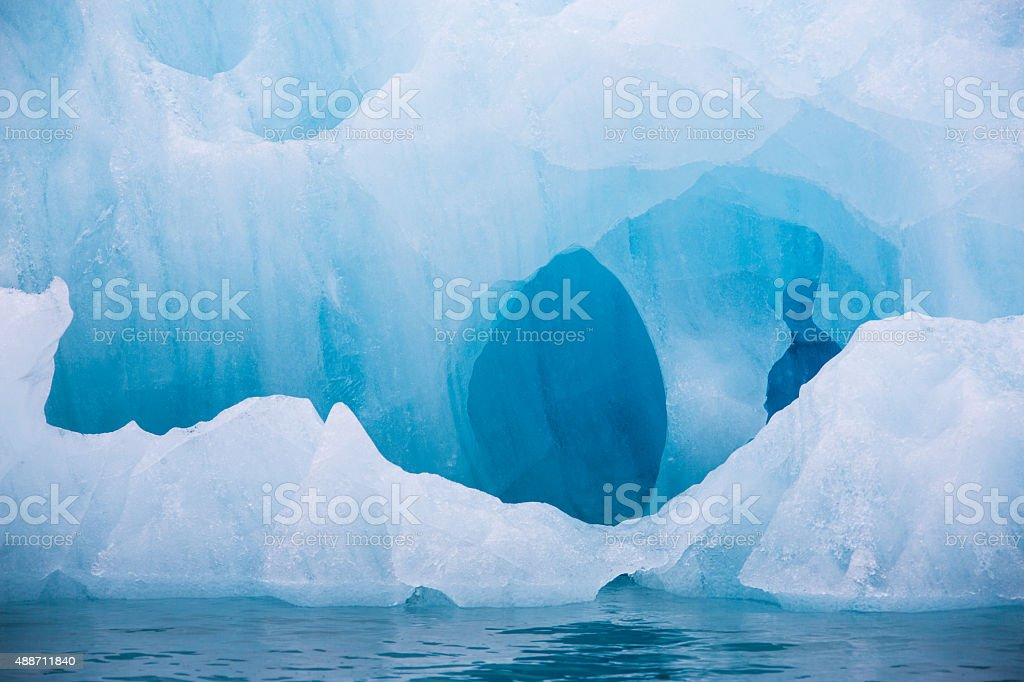 Blue iceberg floating in the Hornsund Spitzbergen stock photo