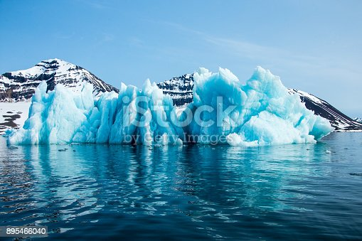 istock Blue iceberg floating in the Hornsund Spitzbergen 895466040