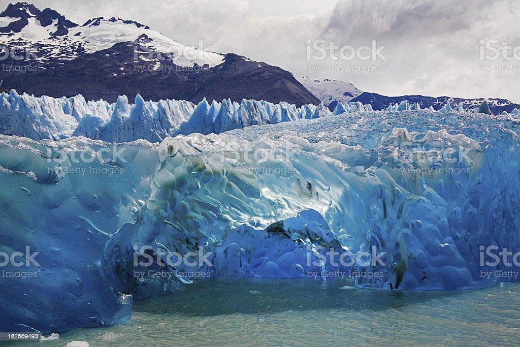 Blue iceberg floating on the Upsala glacier royalty-free stock photo