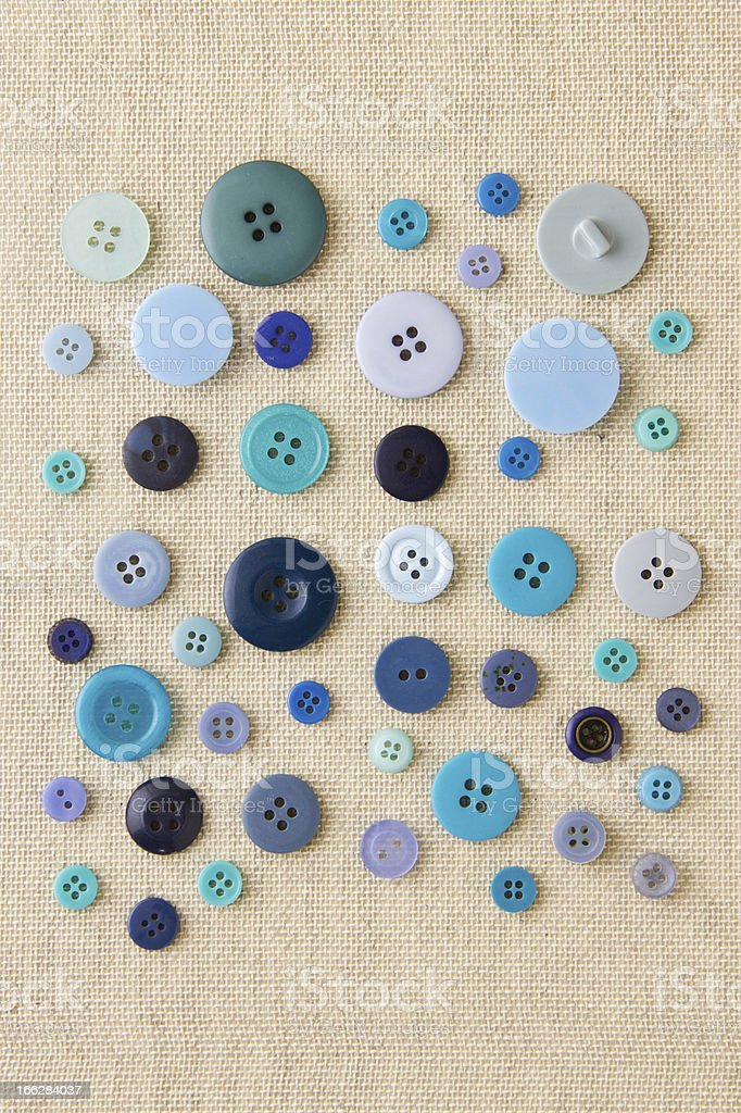 Blue individual buttons on hessian royalty-free stock photo