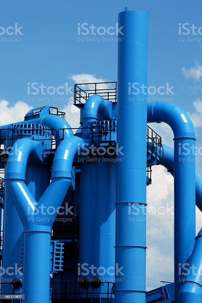 Blue Industrial Installations Against Sky stock photo
