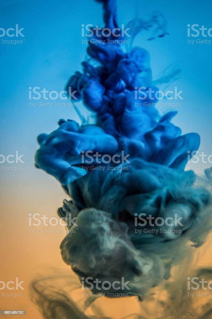 blue ink in water isolated on white background royalty-free stock photo