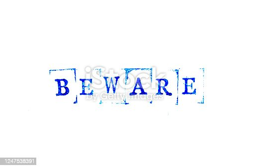 istock Blue ink of rubber stamp in word beware on white paper background 1247538391