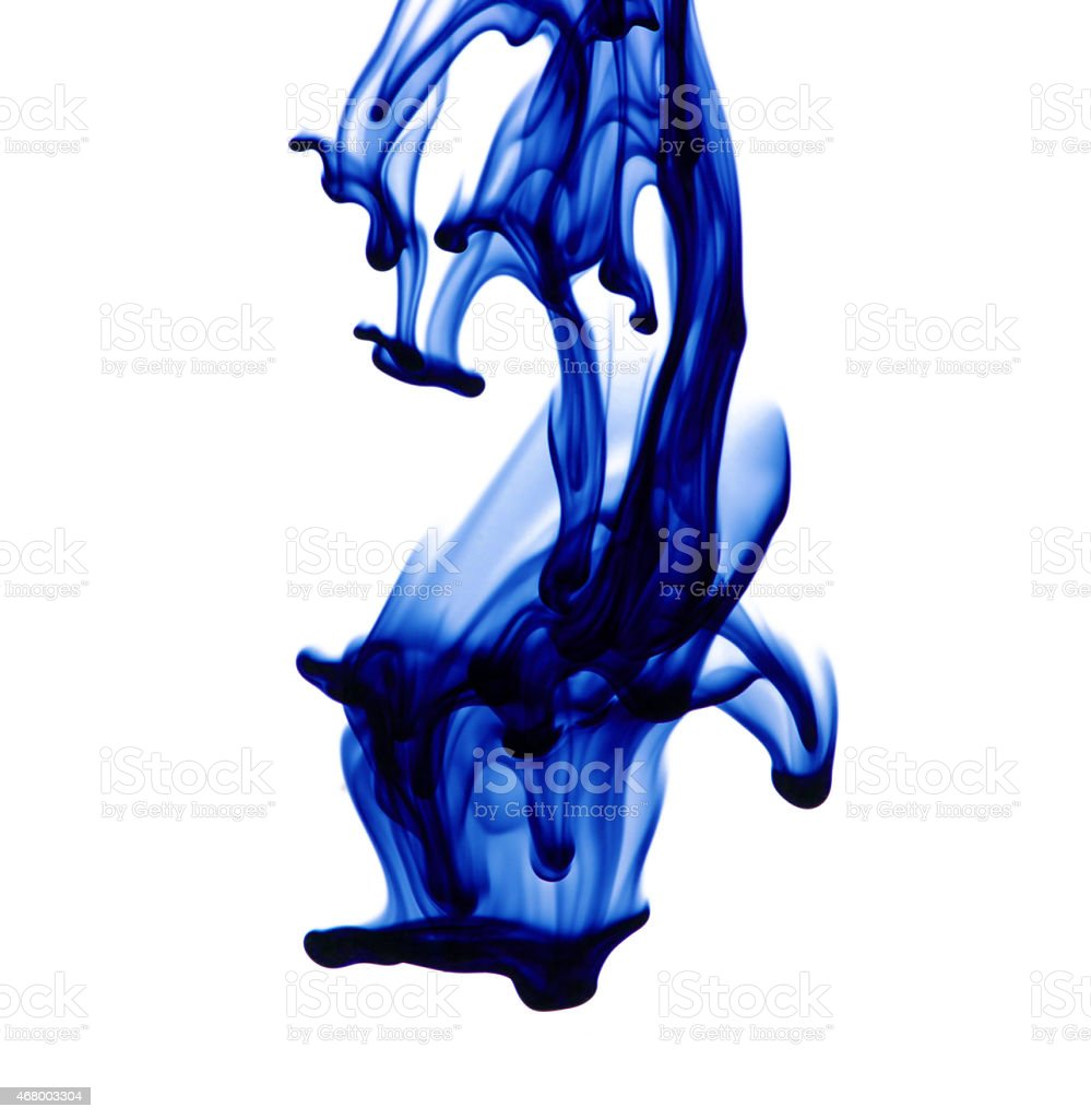 Blue ink on water on a white background stock photo