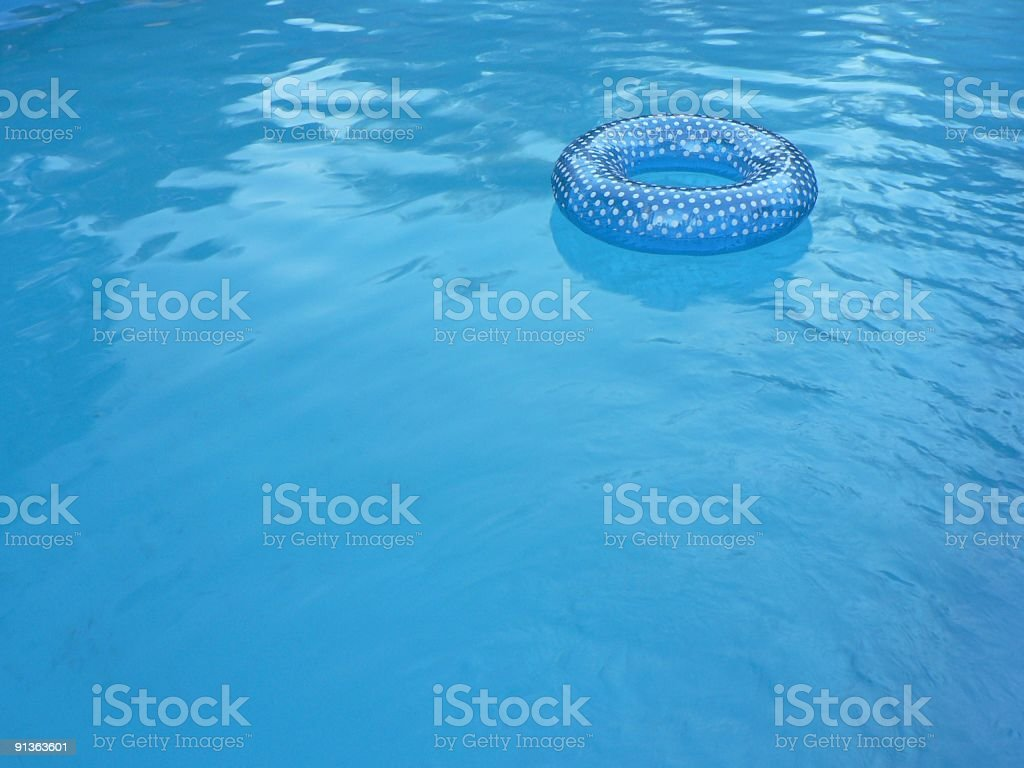 Blue Inner tube in Swimming Pool 2 royalty-free stock photo