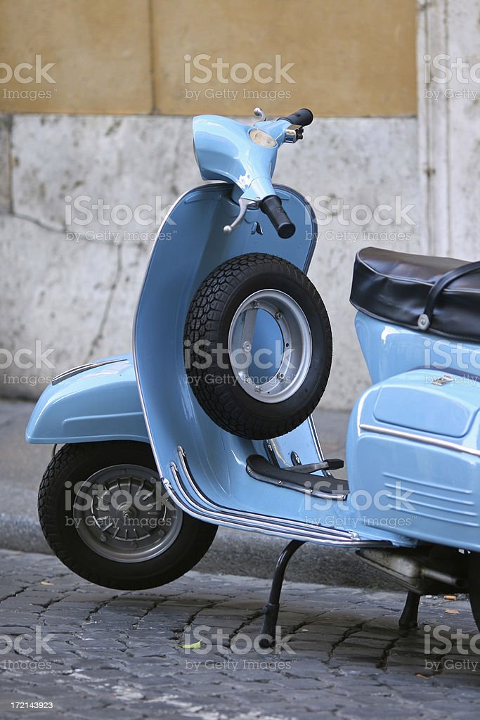 Blue Italian vintage scooter in Rome royalty-free stock photo