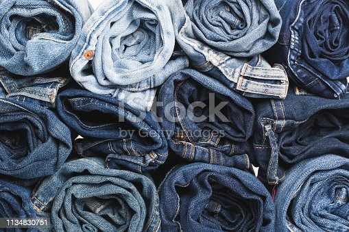 Blue jean background .Blue denim jeans texture. Jeans background. Blue torn denim jeans texture.classic nature tone jean.denim jeans texture background with frayed hole, black fabric grunge background